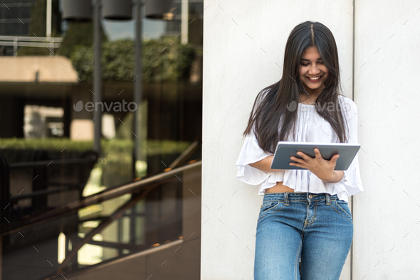 close up portrait student young woman with tablet smiling - Stock Photo - Images