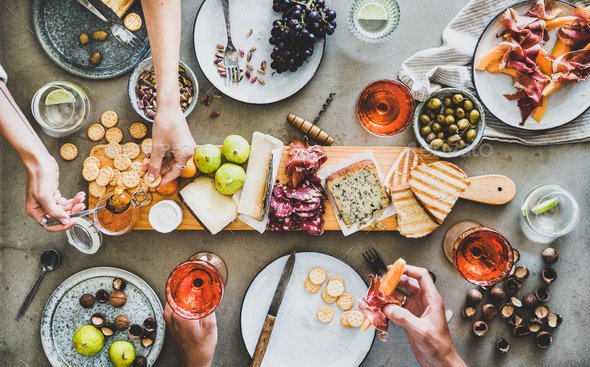 Mid-summer picnic with rose wine, cheese, charcuterie and appetizers - Stock Photo - Images