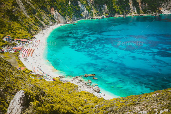 Myrtos beach with azure blue sea water in the bay. Favorite tourist visiting destination place at - Stock Photo - Images
