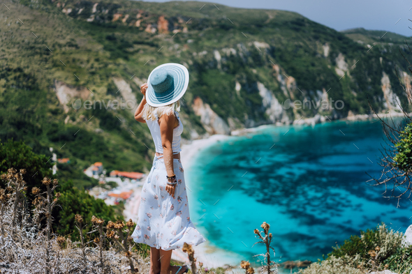 Young woman on Petani beach Kefalonia, admiring highly excited picturesque panorama of emerald blue - Stock Photo - Images