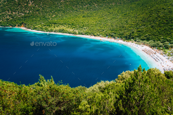 Sunny summer day on Antisamos beach on Kefalonia island, Greece. Crystal clear water, huge hills - Stock Photo - Images