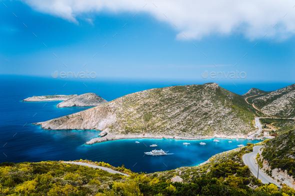 Beautiful blue sea bay of mediterranean sea in Porto Vromi under white clouds, Zakynthos island - Stock Photo - Images