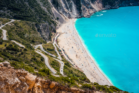 Serpentine road to famous Myrtos Beach. Favorite visiting place on Kefalonia, Greece - Stock Photo - Images