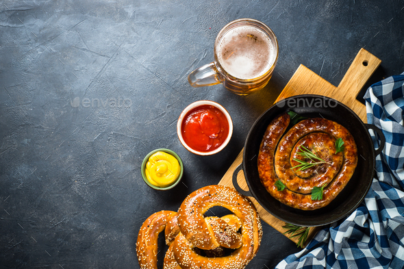 Oktoberfest food - sausage, beer and bretzel - Stock Photo - Images