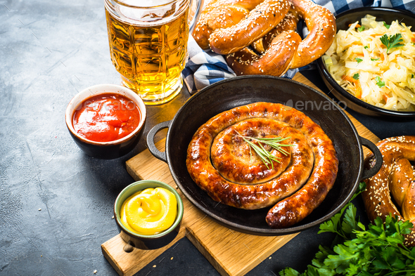 Oktoberfest food - sausage, beer and bretzel - Stock Photo - Images