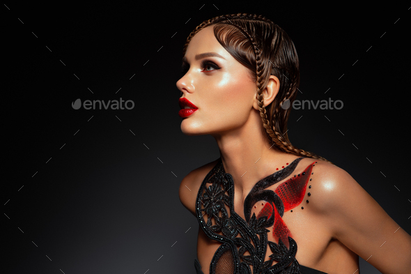 Beautiful young model with red lips and body art - Stock Photo - Images