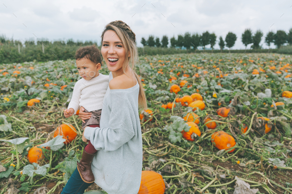 Mother and Daughter in a Pumpkin Patch - Stock Photo - Images