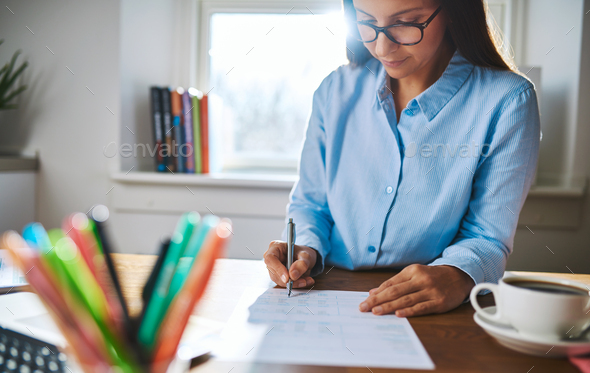 Young businesswoman busy writing notes - Stock Photo - Images