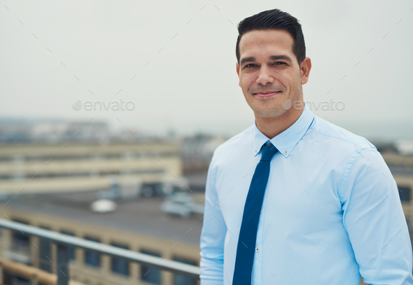Smiling relaxed Hispanic businessman - Stock Photo - Images