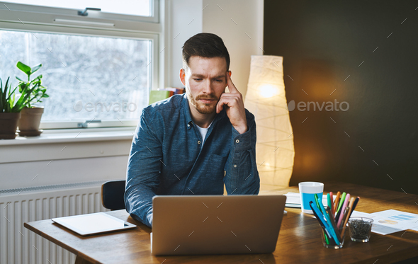 Worried entrepreneur young man working at desk - Stock Photo - Images