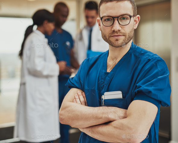 Serious surgeon in front of team - Stock Photo - Images