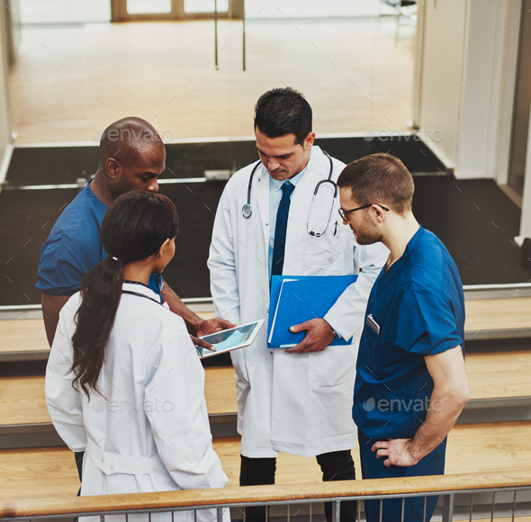Group of doctors in an impromptu meeting - Stock Photo - Images