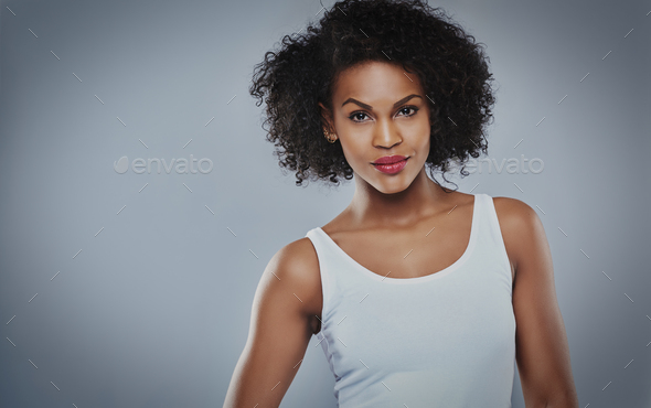 Cute young serious Black woman - Stock Photo - Images
