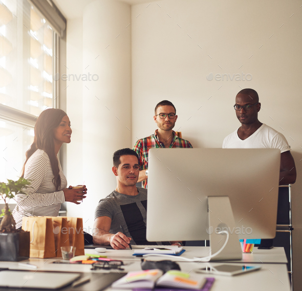 Group of young adults at small business - Stock Photo - Images