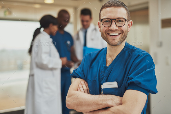 Happy optimistic young hospital surgeon - Stock Photo - Images