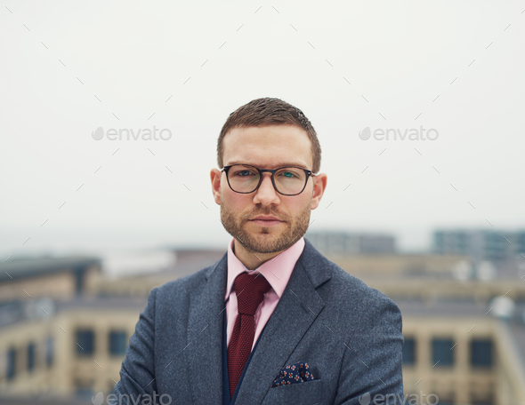 Determined intense young businessman - Stock Photo - Images