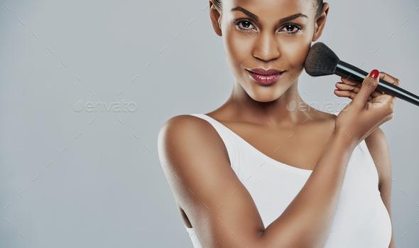 Brushing on beauty - Stock Photo - Images