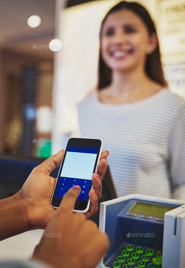 Close up on hands using phone for payment at store - Stock Photo - Images