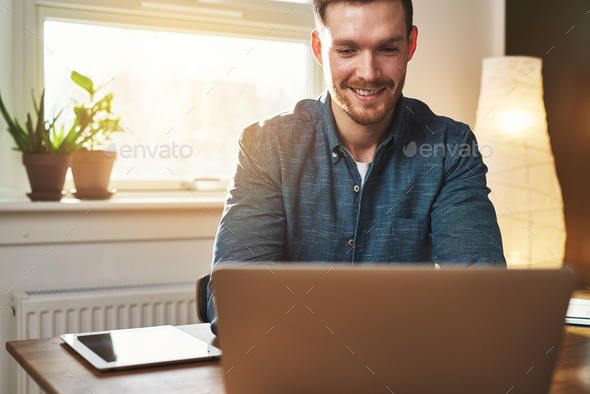 Smiling business entrepreneur in his office - Stock Photo - Images