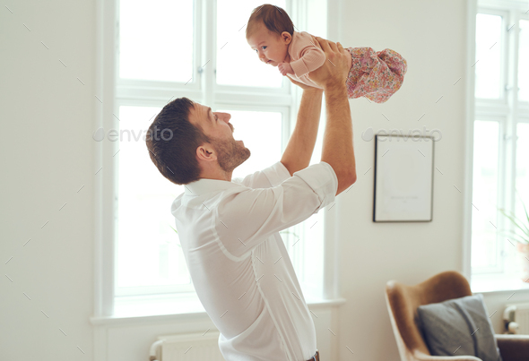 Up goes daddy's little girl! - Stock Photo - Images