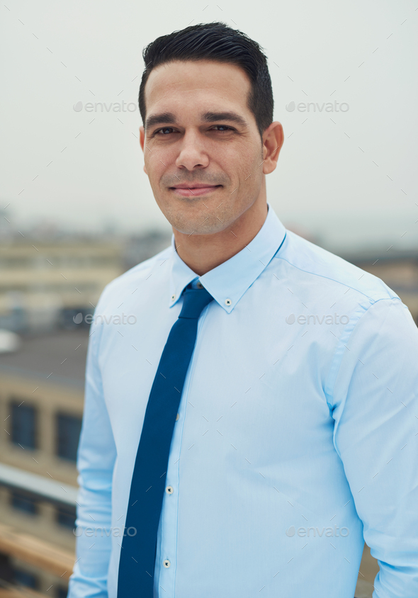 Young handsome Hispanic man on a rooftop - Stock Photo - Images