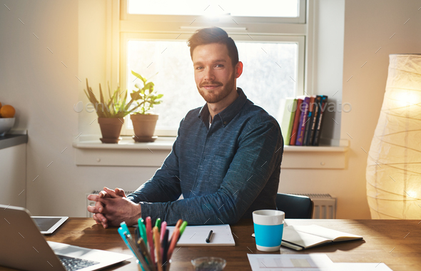 Successful businessman sitting thinking - Stock Photo - Images