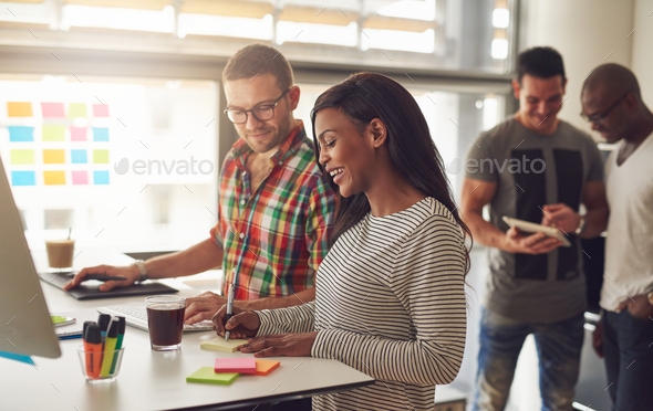 Cheerful young entrepreneurs working in the office - Stock Photo - Images