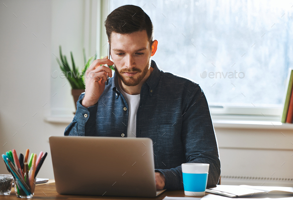Concentrated man working on laptop - Stock Photo - Images