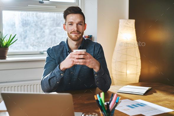 Entrepreneur sitting at his office - Stock Photo - Images