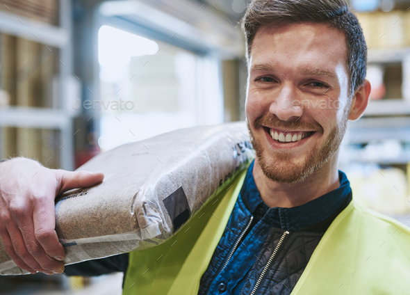 Smiling happy handsome young handyman - Stock Photo - Images