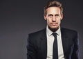 Blond young man wearing business black suit - PhotoDune Item for Sale