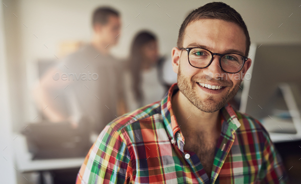 Cheerful entrepreneur wearing glasses in the office - Stock Photo - Images