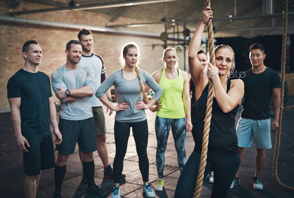 Woman holding climbing rope in cross-fit exercises - Stock Photo - Images