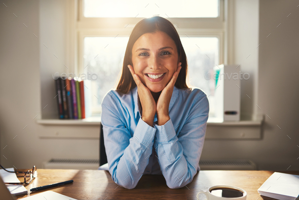 Business woman smiling at camera - Stock Photo - Images