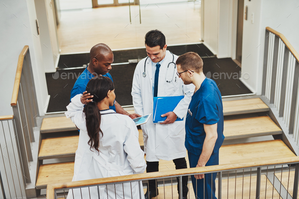 Confident team of doctors talking - Stock Photo - Images