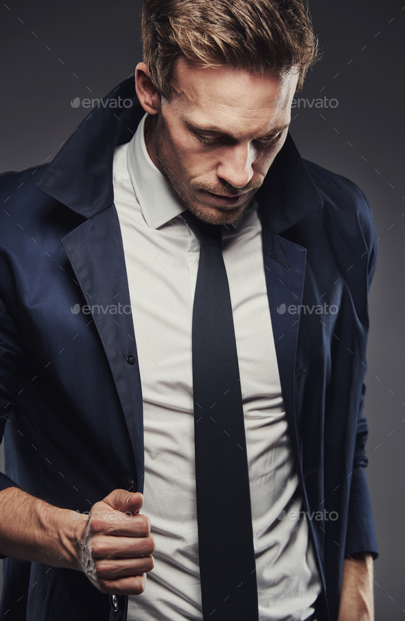 Snappy dressed business man with collar turned up - Stock Photo - Images