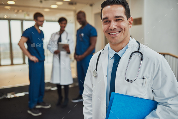 Successful handsome doctor with a beaming smile - Stock Photo - Images