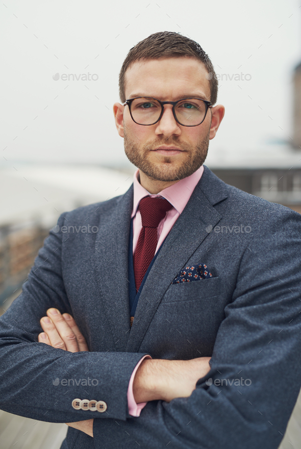 Serious determined young business man - Stock Photo - Images