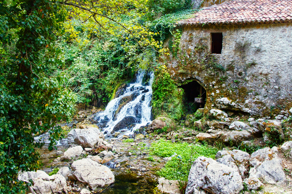 Ancient water mill in the natural reserve of Morigerati - Stock Photo - Images