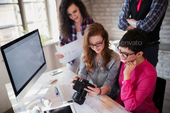 Group of young perspective designers working with camera - Stock Photo - Images