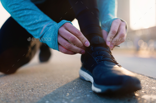 Runner trying running shoes getting ready for run - Stock Photo - Images