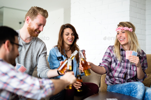 Friends having fun and smiling together indoors - Stock Photo - Images