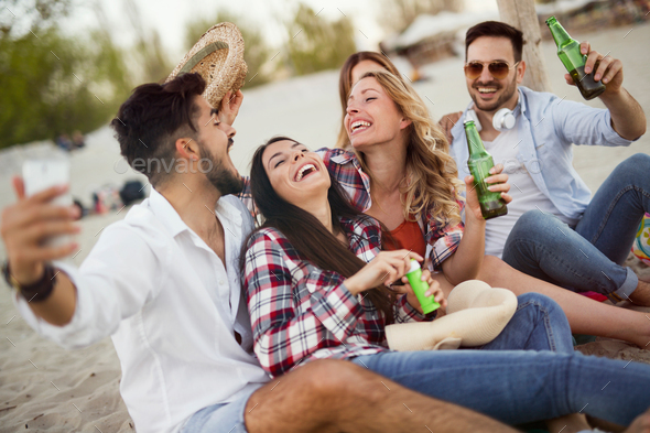 Group of cheerful friends having great time at beach - Stock Photo - Images
