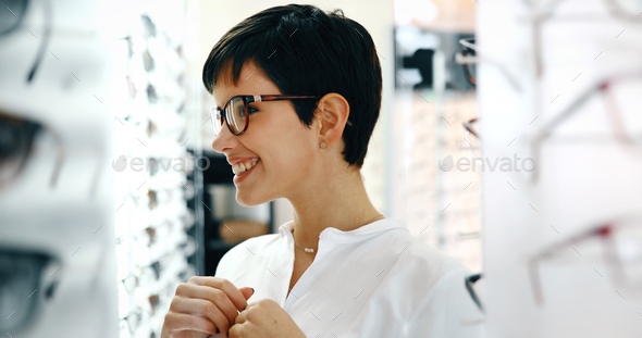 Beautiful woman with optician trying eyeglasses - Stock Photo - Images
