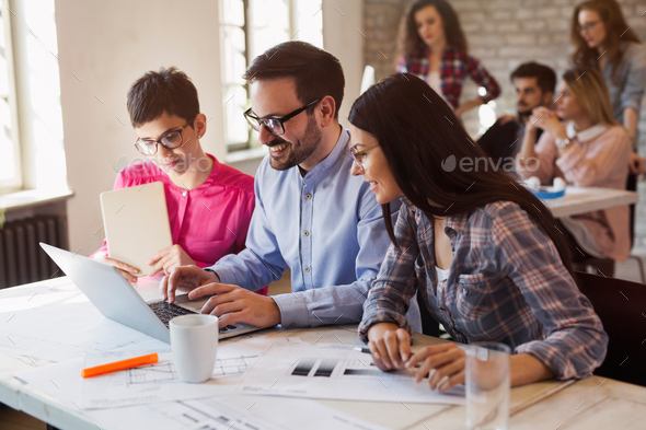 Group of young architects working on computer - Stock Photo - Images