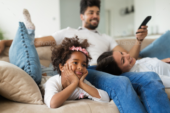 Family watches movie while sitting on the couch - Stock Photo - Images