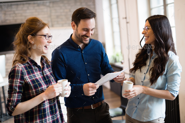 Portrait of architects having discussion in office - Stock Photo - Images