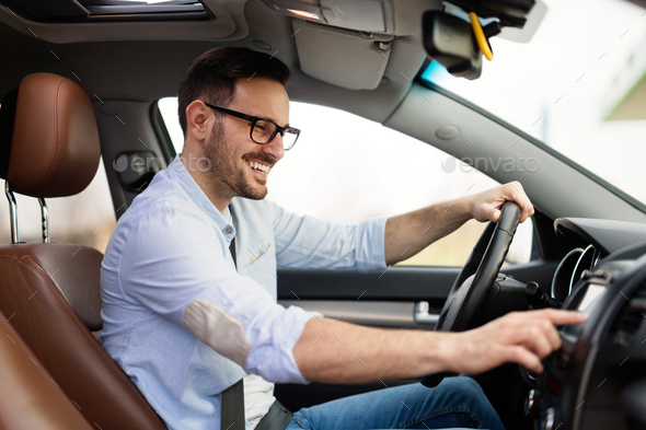 Man Using Gps Navigation System In Car to travel - Stock Photo - Images