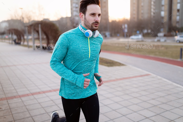 Young fitness man running in urban area - Stock Photo - Images