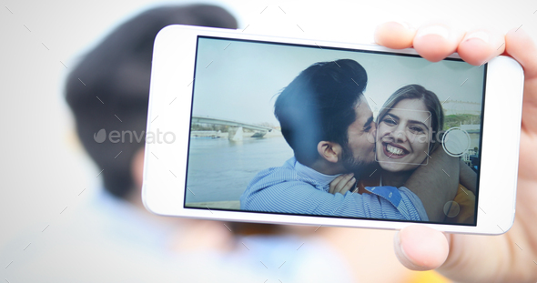 Happy couple having fun and taking a selfie - Stock Photo - Images